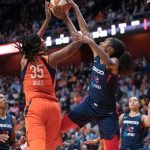 Connecticut Sun center Jonquel Jones (35) is blocked by Washington Mystics forward LaToya Sanders (30) during Game 4 of the WNBA finals between the Washington Mystics and the Connecticut Sun at Mohegan Sun Arena, Uncasville, CT, USA on October 08, 2019. Photo Credit: Chris Poss