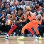 Washington Mystics guard Ariel Atkins (7) is defended by Connecticut Sun guard Courtney Williams (10) during Game 4 of the WNBA finals between the Washington Mystics and the Connecticut Sun at Mohegan Sun Arena, Uncasville, CT, USA on October 08, 2019. Photo Credit: Chris Poss