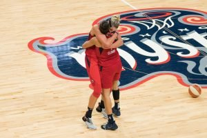 Washington Mystics forward Elena Delle Donne (11) and Washington Mystics guard Natasha Cloud (9) embrace after Game 5 of the WNBA finals between the Connecticut Sun and the Washington Mystics at Entertainment and Sports Arena, Washington, DC, USA on October 10, 2019. Photo Credit: Chris Poss