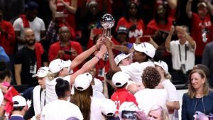The Washington Mystics hoist the WNBA Championship trophy after beating the Connecticut Sun. Rob Carr/NBAE via Getty Images.