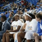 Michaela Onyenwere and Lindsey Corsaro talk on the bench. Maria Noble/WomensHoopsWorld