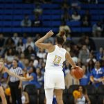 Jaden Owens looks for a passing option. Maria Noble/WomensHoopsWorld