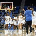 UCLA celebrates their win over Weber State. Maria Noble/WomensHoopsWorld