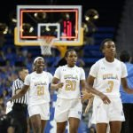Bruin players slap hands at the end of the game. Maria Noble/WomensHoopsWorld