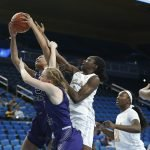 Kayla Owens gets her hand on the ball. Maria Noble/WomensHoopsWorld