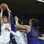 Natalie Chou grabs a rebound. Maria Noble/WomensHoopsWorld
