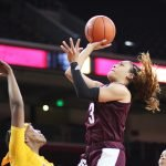 Chennedy Carter shoots over the USC defense. Maria Noble/WomensHoopsWorld
