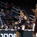 Chennedy Carter talks with coach Gary Blair during a game pause. Maria Noble/WomensHoopsWorld