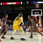 Kayla Wells moves the ball around the screen. Maria Noble/WomensHoopsWorld