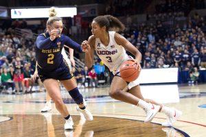 Megan Walker slashes to the basket. Photo courtesy of UConn Athletics.