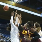 Players from both teams scramble for a rebound. Maria Noble/WomensHoopsWorld.