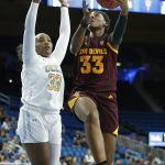 Ja'Tavia Tapley goes up against Lauryn Miller. Maria Noble/WomensHoopsWorld.