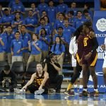 A foul stops play in the first quarter. Maria Noble/WomensHoopsWorld.