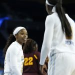 Japreece Dean and Michaela Onyenwere exchange words. Maria Noble/WomensHoopsWorld.
