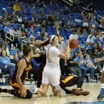 Lindsey Corsaro comes up with the ball and looks to pass. Maria Noble/WomensHoopsWorld.
