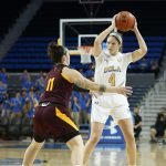 Lindsey Corsaro looks to pass. Maria Noble/WomensHoopsWorld.