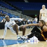 Players get up after a collision. Maria Noble/WomensHoopsWorld.