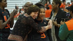 Hurricanes coach Katie Meier hugs Destiny Harden. Photo courtesy of Miami Athletics.