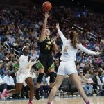 Sabrina Ionescu shoots over Chantel Horvat. Maria Noble/WomensHoopsWorld.
