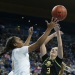 Charisma Osborne battles for ball possession with Taylor Chavez. Maria Noble/WomensHoopsWorld.