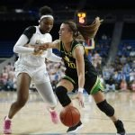 Sabrina Ionescu pushes pas Lauryn Miller. Maria Noble/WomensHoopsWorld.