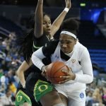 Lauryn Miller muscles past Ruthy Hebard. Maria Noble/WomensHoopsWorld.