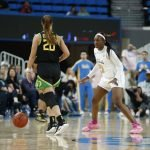Michaela Onyenwere defends Sabrina Ionescu. Maria Noble/WomensHoopsWorld.