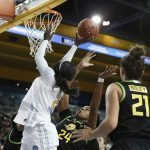 Michaela Onyenwere arches to make a layup. Maria Noble/WomensHoopsWorld.