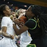 Charisma Osborne and Ruthy Hebard fight for ball possession. Maria Noble/WomensHoopsWorld.