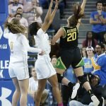 Sabrina Ionescu throws up a windmill-type layup. Maria Noble/WomensHoopsWorld.