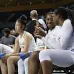 Charisma Osborne and Lauryn Miller talk on the bench. Maria Noble/WomensHoopsWorld.