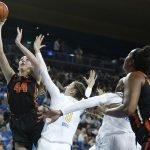 Taylor Jones powers through the UCLA defense for a layup. Maria Noble/WomensHoopsWorld.