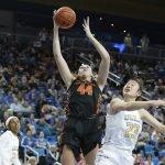 Taylor Jones grabs a rebound. Maria Noble/WomensHoopsWorld.