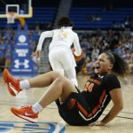 Destiny Slocum reacts after twisting an ankle. Maria Noble/WomensHoopsWorld.