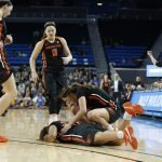 Teammates come to the aid of Destiny Slocum. Maria Noble/WomensHoopsWorld.