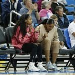 Former UCLA greats Jordin Canada and Kelli Hayes wait to see if their former team will rally from behind. Maria Noble/WomensHoopsWorld.