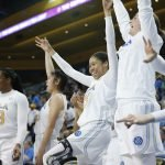 The UCLA bench erupts as their teammates tie the score with Oregon State. Maria Noble/WomensHoopsWorld.