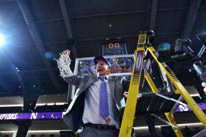 Coach Joe McKeown cuts down the net. S.J. Carrera, Inc. photo.
