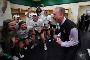 Coach Michael Meek and the Portland Pilots have fun in the locker room after earning the program's first NCAA Tournament berth last month. Kyle Terada photo.