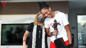 WNBA commissioner Cathy Engelbert hugs Las Vegas Aces forward A'ja Wilson after presenting her with the 2020 Most Valuable Player award. Photo courtesy of the Las Vegas Aces.