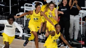 Seattle Storm players charge the court at the sound of the final buzzer, which gave them the Championship win. NBAE via Getty Images photo, courtesy of Seattle Storm.