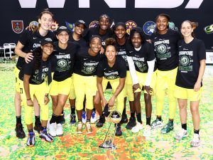 The Seattle Storm pose with the trophy last week after winning the 2020 WNBA Championship. NBAE via Getty Images photo, courtesy of WNBA.