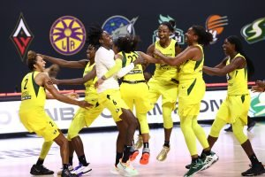 PALMETTO, FL - OCTOBER 6:  The Seattle Storm celebrate after defeating the Las Vegas Aces and winning the 2020 WNBA Championship in Game Three of the WNBA Finals against the Las Vegas Aces. Photo by Ned Dishman/NBAE via Getty Images.