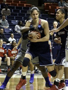 Duquesne and Seton Hall players battle for the ball. Photo by Robert Franklin.