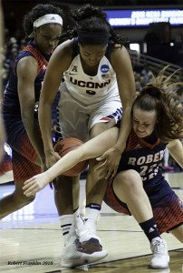 Connecticut and Robert Morris players battle for the loose ball. Photo by Robert Franklin.