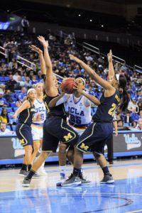Monique Billings scores on a falling shot. Photo by Zyaire Porter/T.G.Sportstv1.