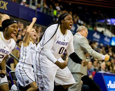 Chantel Osahor and the rest of the bench cheer the efforts of their Husky teammates in the closing minutes of Friday's win over Arizona. Photo courtesy of Washington Athletics.