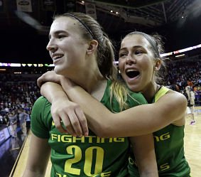 Sabrina Ionescu and Lexi Bando celebrate Oregon's upset win over Washington Friday in the Pac 12 Tournament. AP Photo by Elaine Thompson.