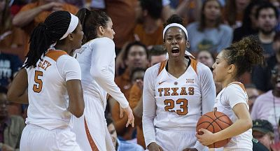 Ariel Atkins, center, and the rest of the Longhorns exult after their win over NC State Sunday. Photo courtesy of Texas Athletics.
