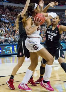 A'ja Wilson tries to pass over Erica McCall. Photo by Robert Franklin.